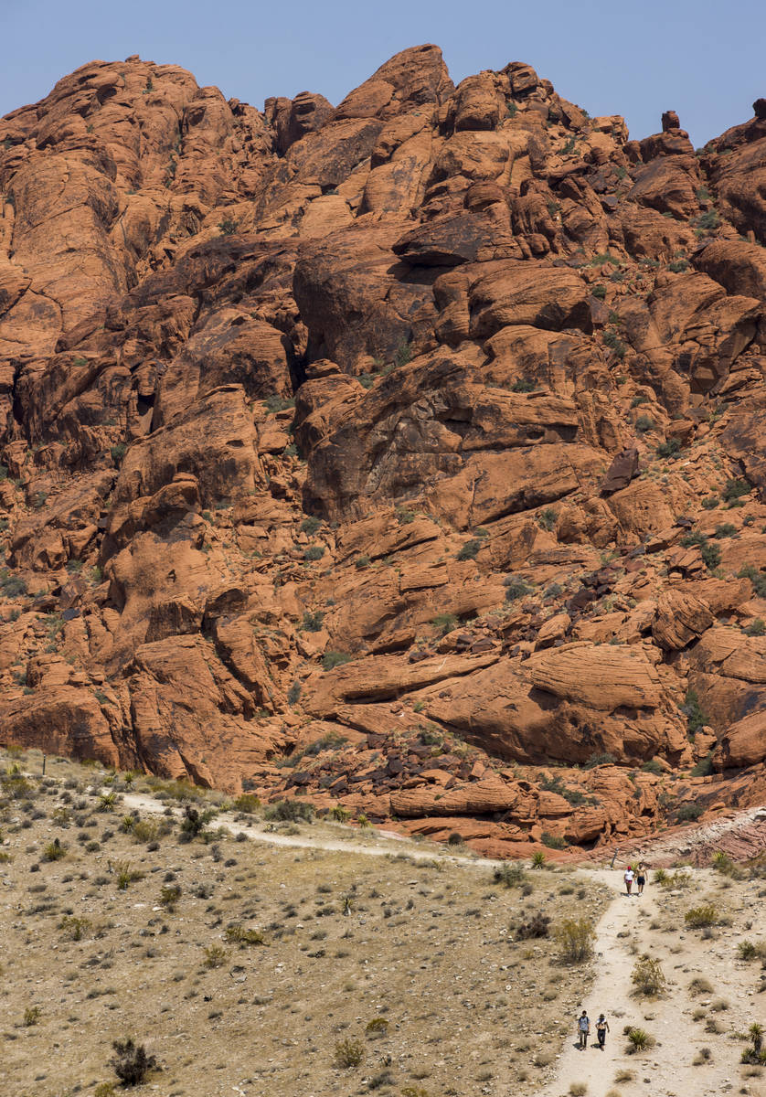 Hikers make their way along the Calico I trail in the Red Rock Canyon National Recreation Area ...