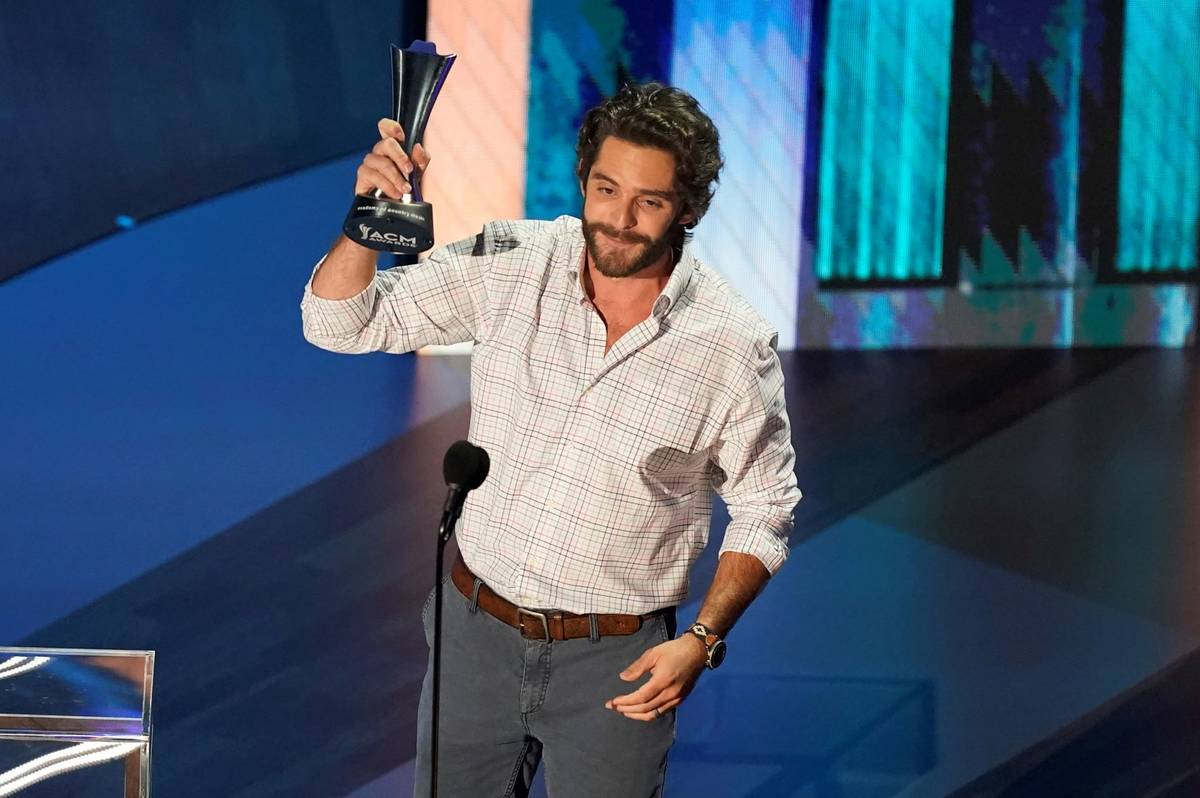 Thomas Rhett accepts the entertainer of the year award in a tie with Carrie Underwood during th ...