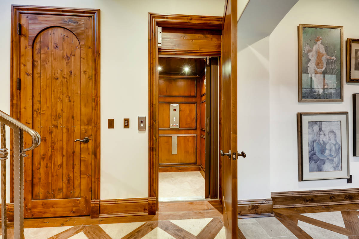 The two-story, 9,741-square-foot main house has an elevator that connects the levels. (The Cram ...