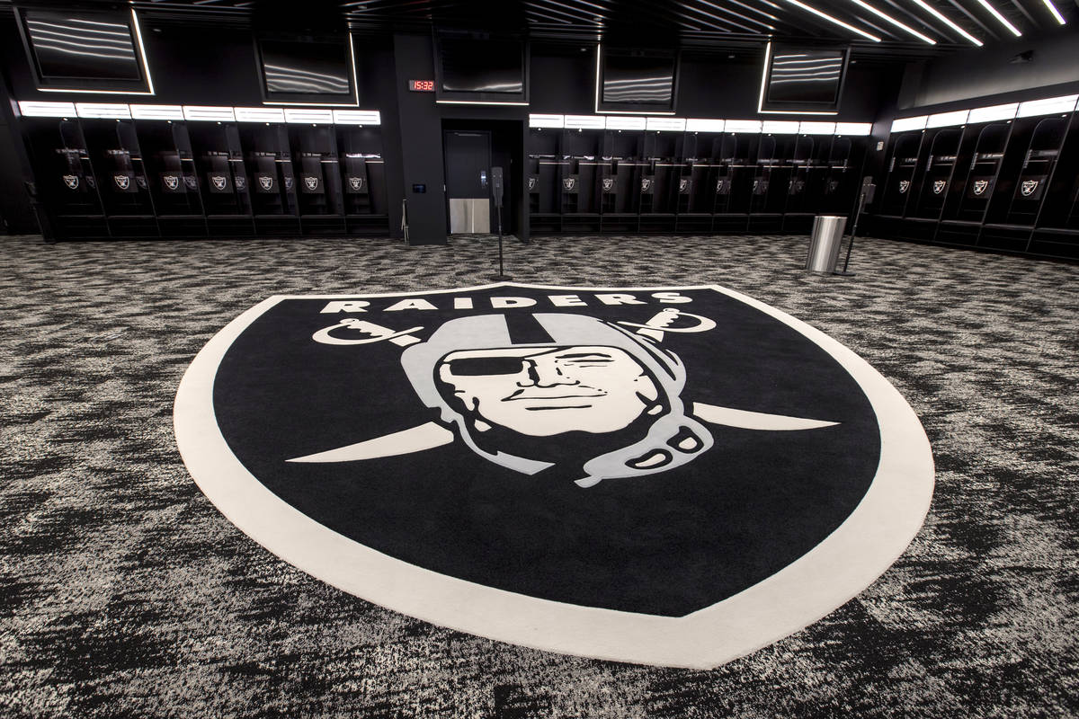 The locker room for the Las Vegas Raiders features a large logo and plenty of room to move for ...