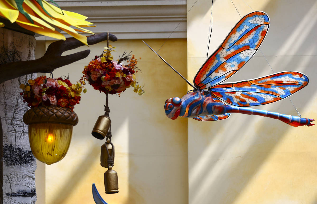"""A dragonfly is part of the """"Into the Woods"""" fall display at the Bellagio Conservatory and Botan ..."""