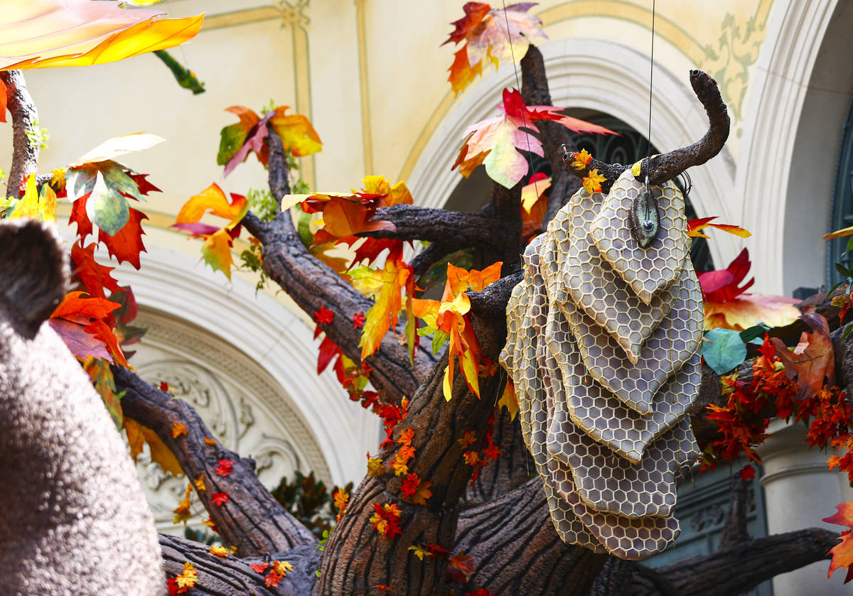 """A honeycomb on a tree is part of the """"Into the Woods"""" fall display at the Bellagio Conservatory ..."""
