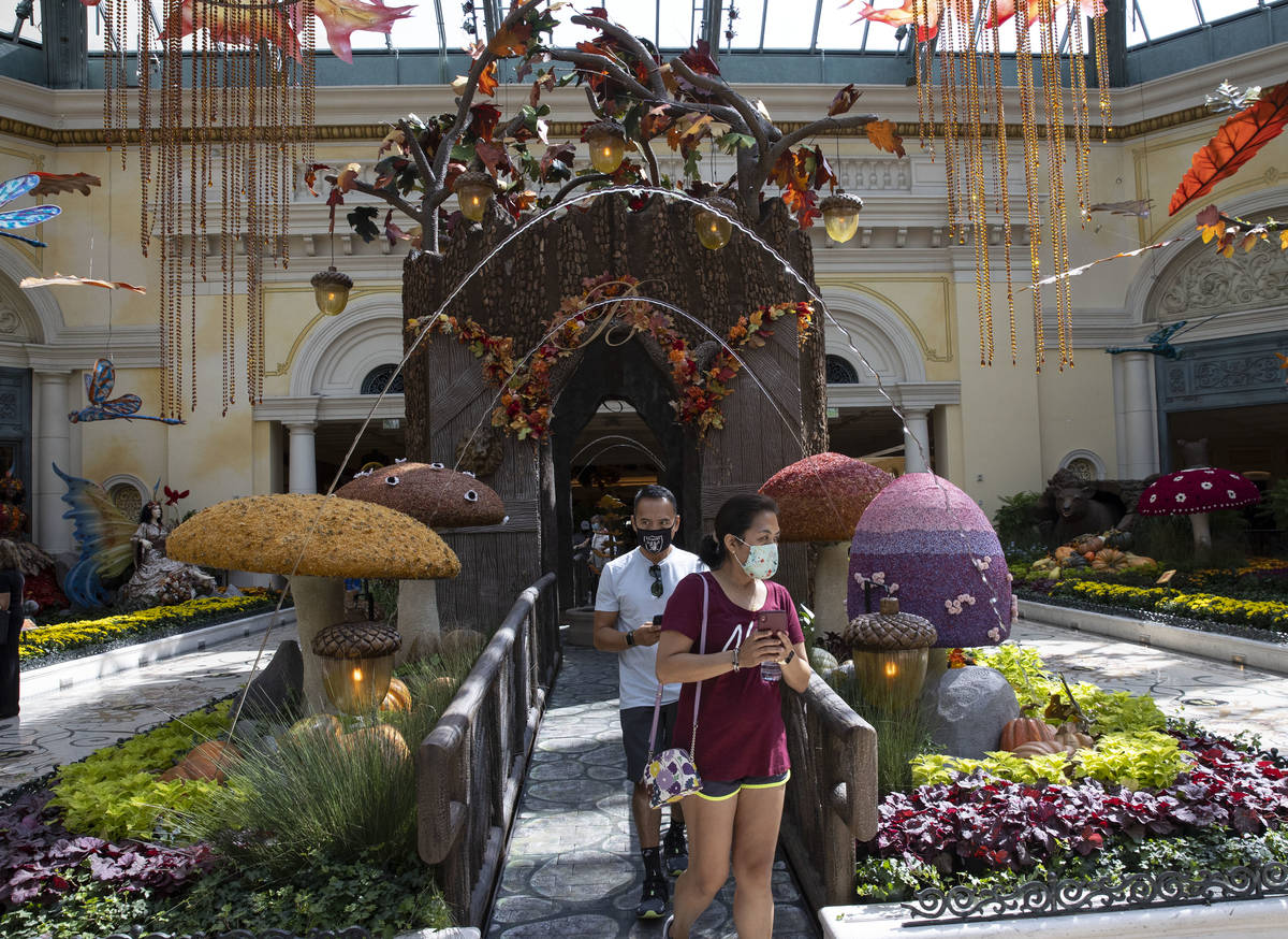 """Tourists visit the new fall display called """"Into the Woods"""" at the Bellagio Conservatory on Tue ..."""