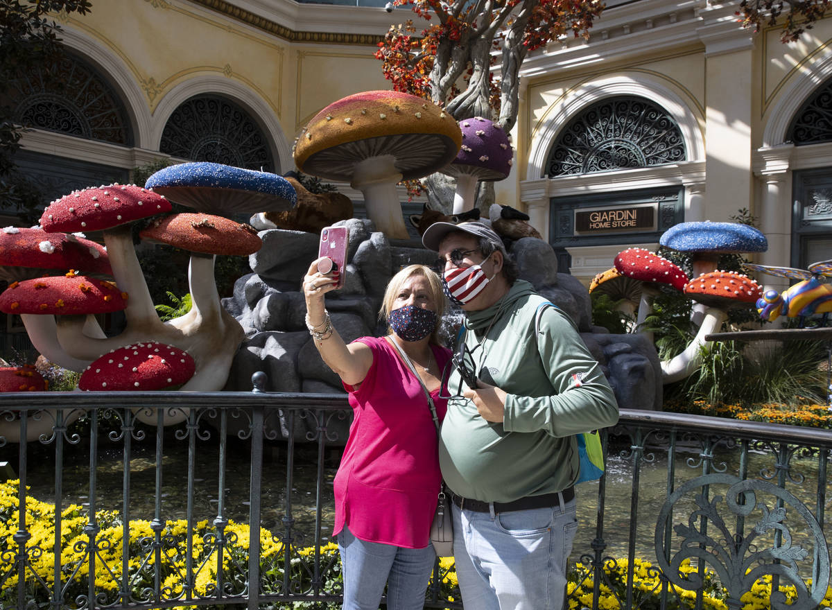 Marisel Vazquez, left, takes a selfie with Camilo Lopez, both visiting from Cuba, as they visit ...