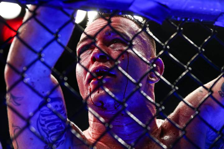 Blood drips from the face of Colby Covington after losing via technical knockout to Kamaru Usm ...