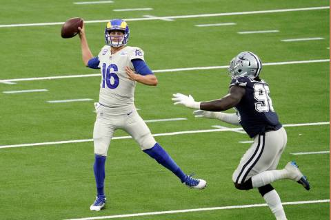 Los Angeles Rams quarterback Jared Goff throws against the Dallas Cowboys during the first half ...