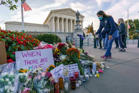 People gather at the Supreme Court on the morning after the death of Justice Ruth Bader Ginsbur ...