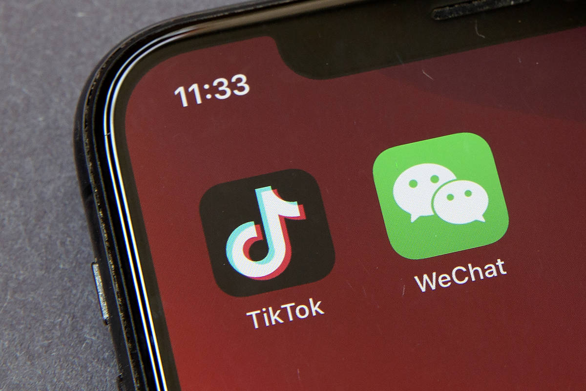 Icons for the smartphone apps TikTok and WeChat are seen on a smartphone screen in Beijing, in ...