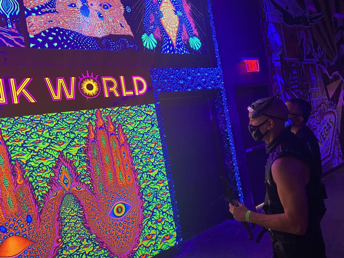 Area15 Director of Content Chris Wink is shown at the entrance of Wink World, designed by artis ...