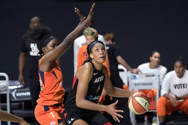 Las Vegas Aces center A'ja Wilson (22) sets up for a shot under the basket in front of Connecti ...