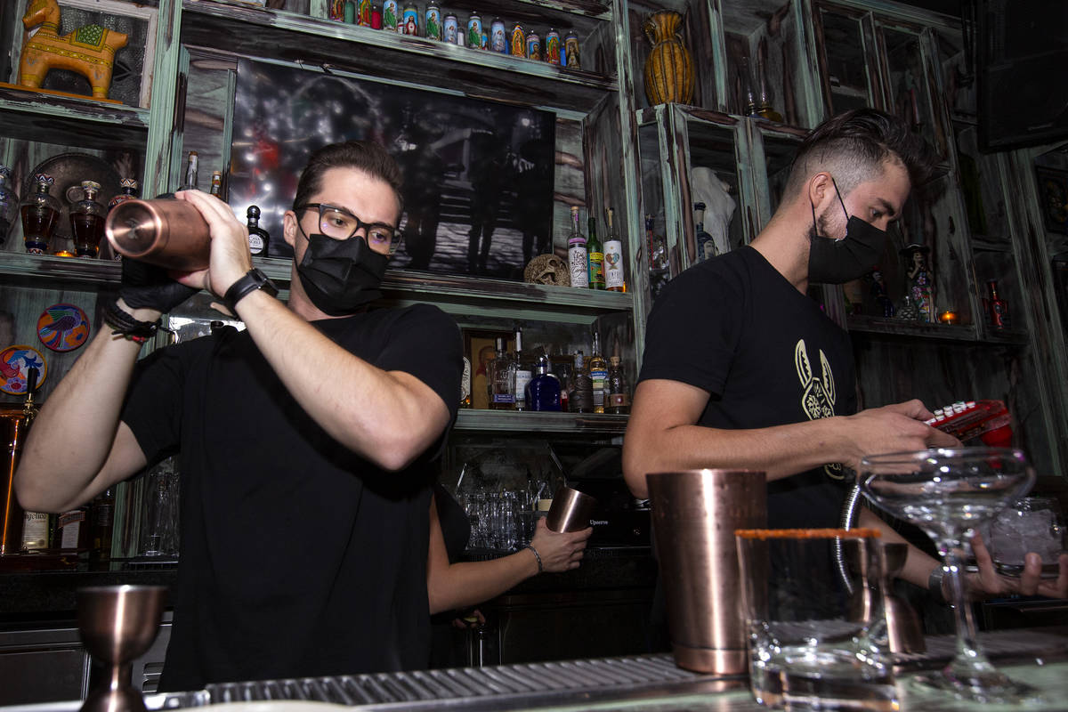 Bartender Chance Bennett, left, shakes a cocktail at Lucky Day Tequila & Mezcal House on th ...