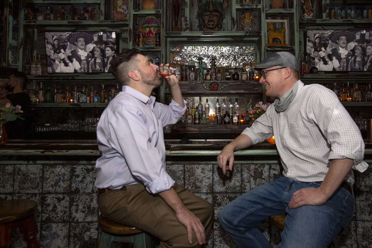 Pete Cangelosi, left, and Mike Silva, right, are the first to order drinks at the bar at Lucky ...