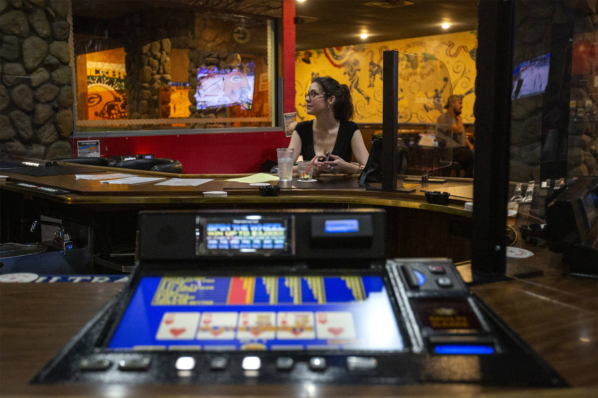 Kirsten Kilburn enjoys a drink at Jackson's Bar and Grill, which opened its bar for the first t ...