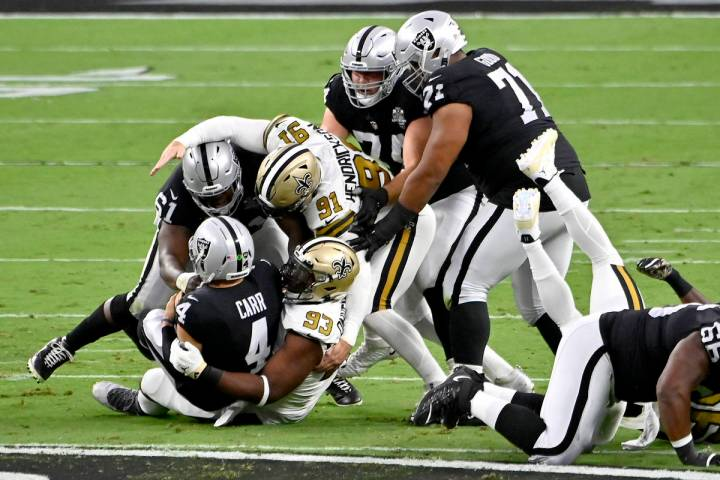 New Orleans Saints defensive tackle David Onyemata (93) sacks Las Vegas Raiders quarterback Der ...