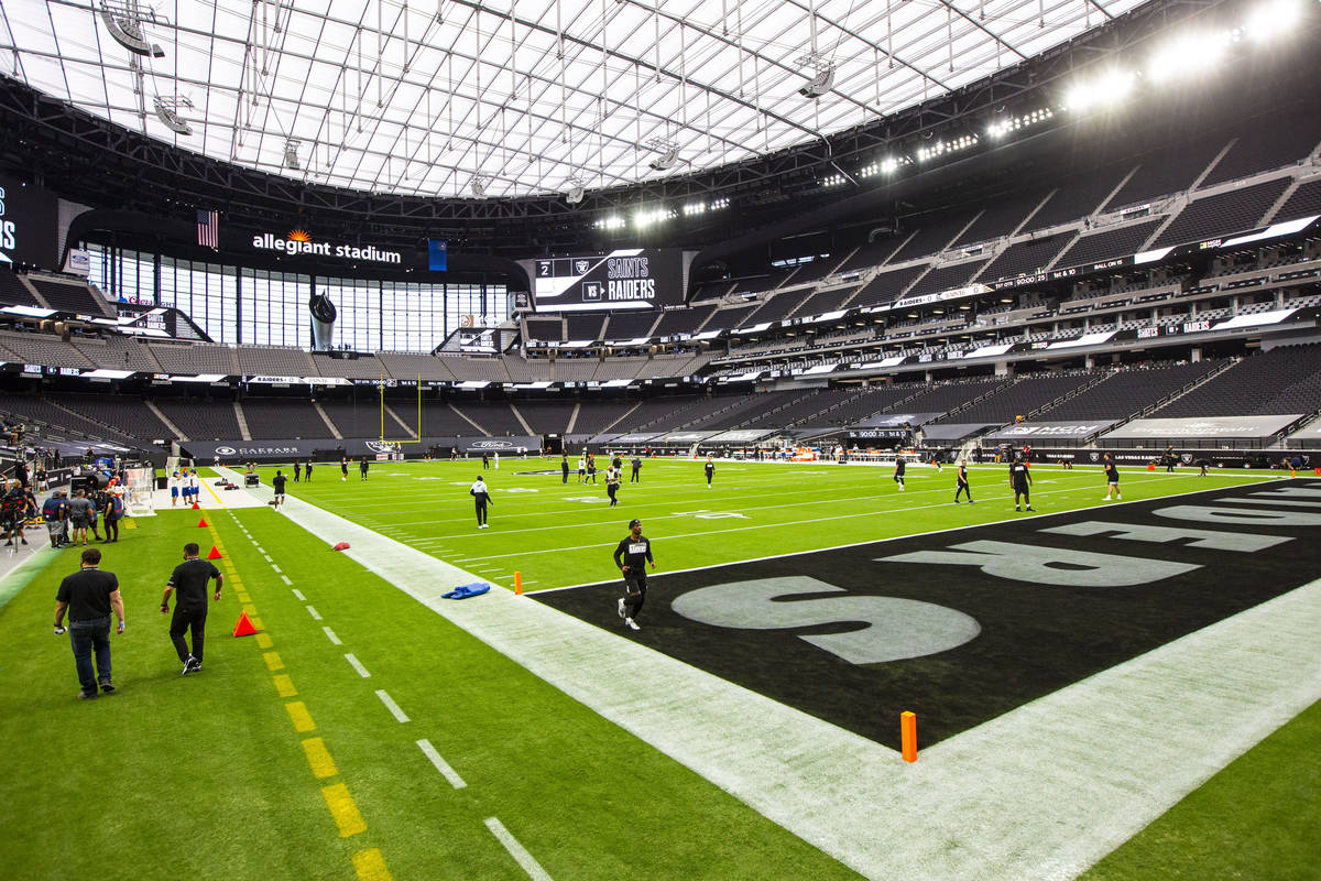 Las Vegas Raiders players warm up before their home opening NFL football game at Allegiant Stad ...