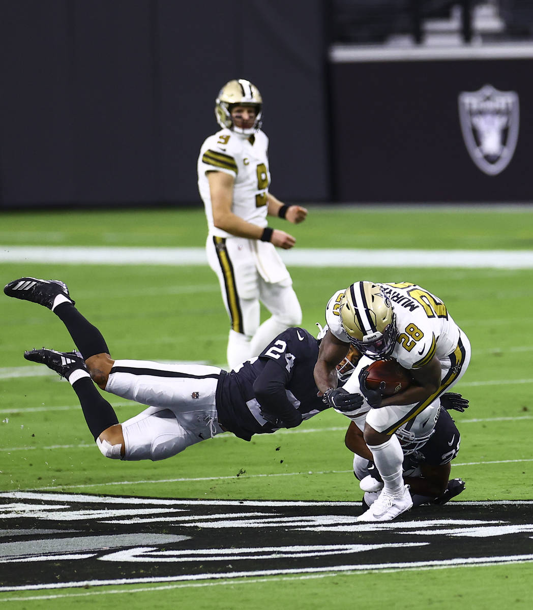 Las Vegas Raiders safety Johnathan Abram (24) tackles New Orleans Saints running back Latavius ...