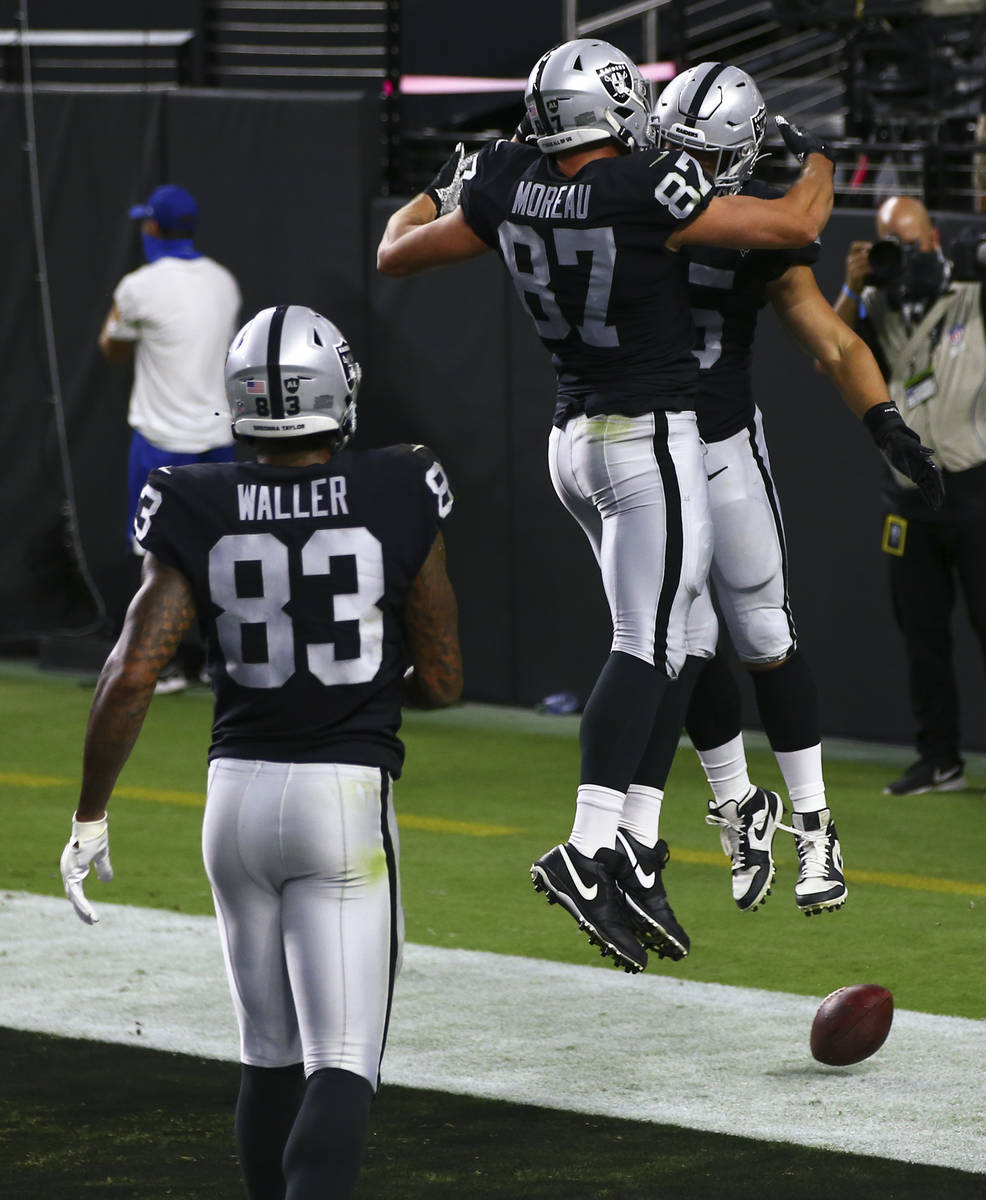 Las Vegas Raiders fullback Alec Ingold, right, celebrates with tight end Foster Moreau (87) aft ...