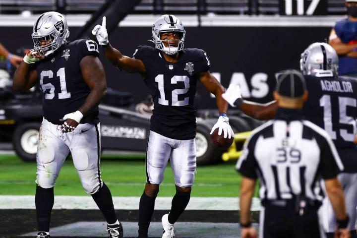 Las Vegas Raiders wide receiver Zay Jones (12) celebrates after scoring a touchdown against the ...