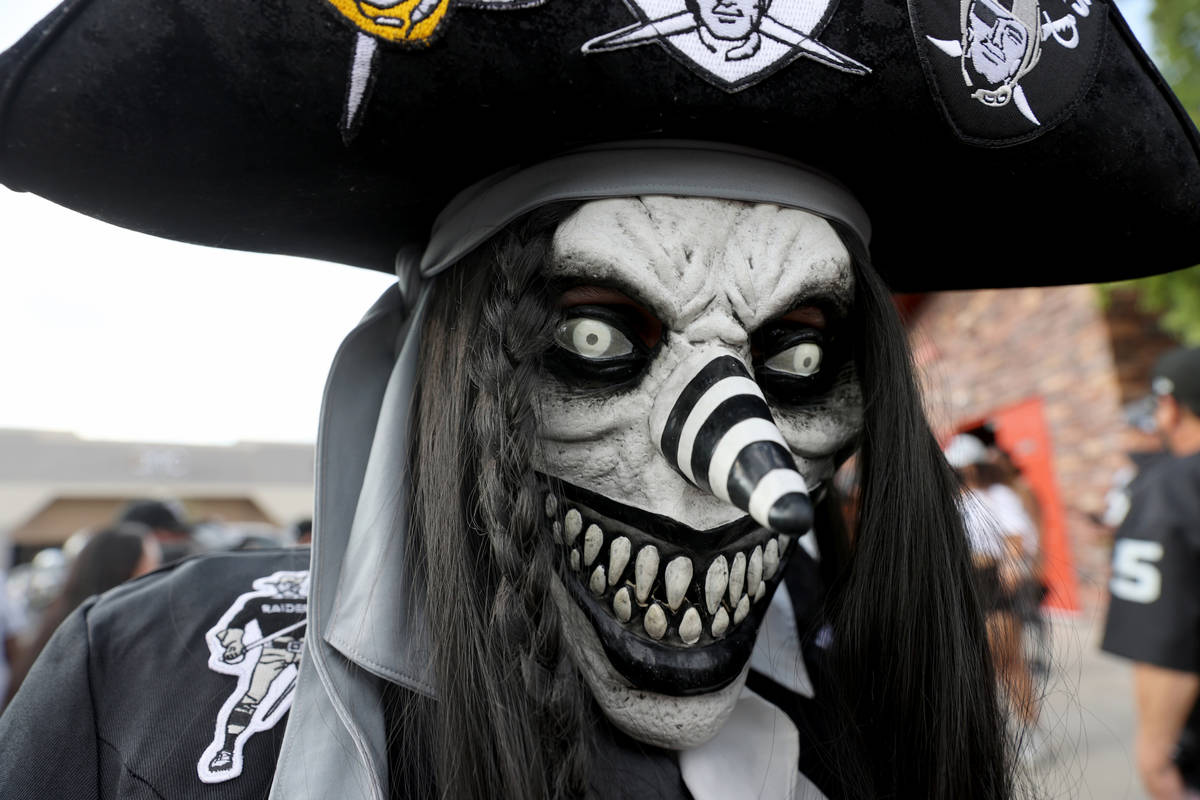 Survarious Twoknives of Bakersfield, Calif. poses during a Las Vegas Raiders watch party at Tom ...