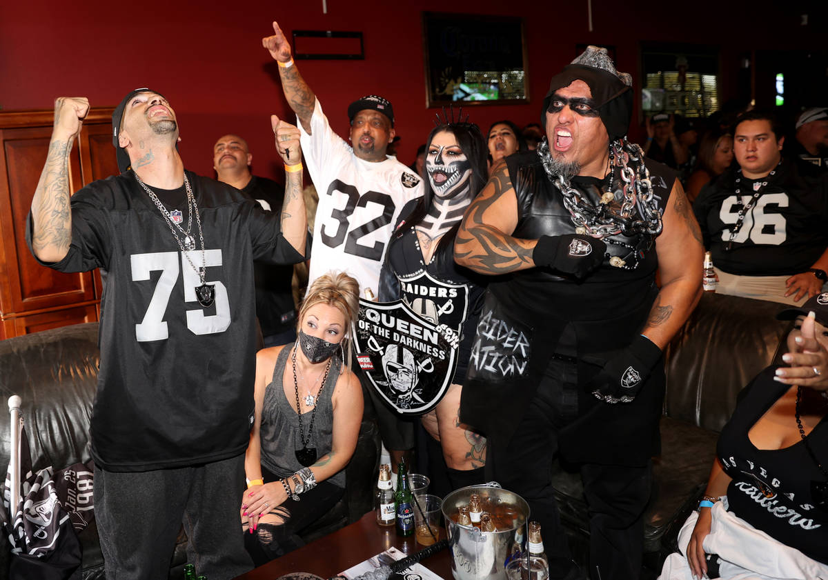 Fans, from left, James Weatherbie, his wife Savana, of Rowland Heights, Calif., Paul Lopez, his ...