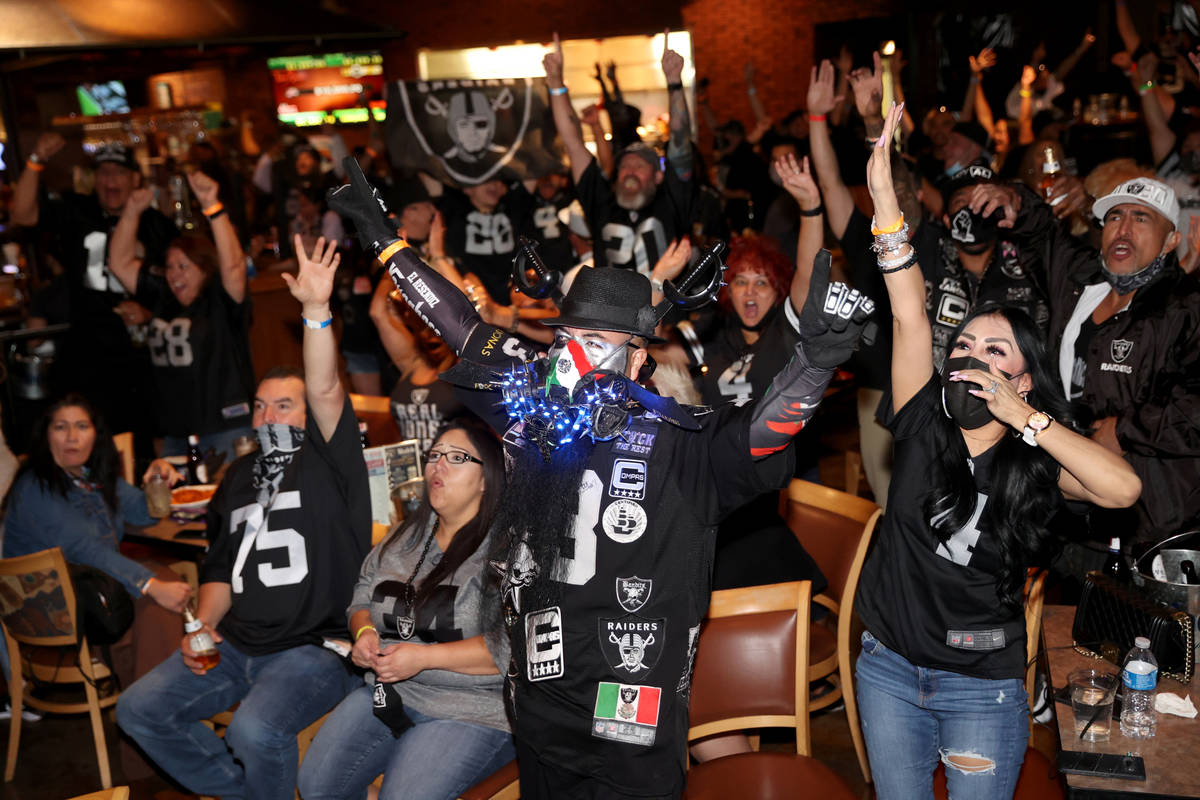 Las Vegas Raiders fans, including Cesar Resendiz and his wife Maria Andrade of Tucson, Ariz. ch ...