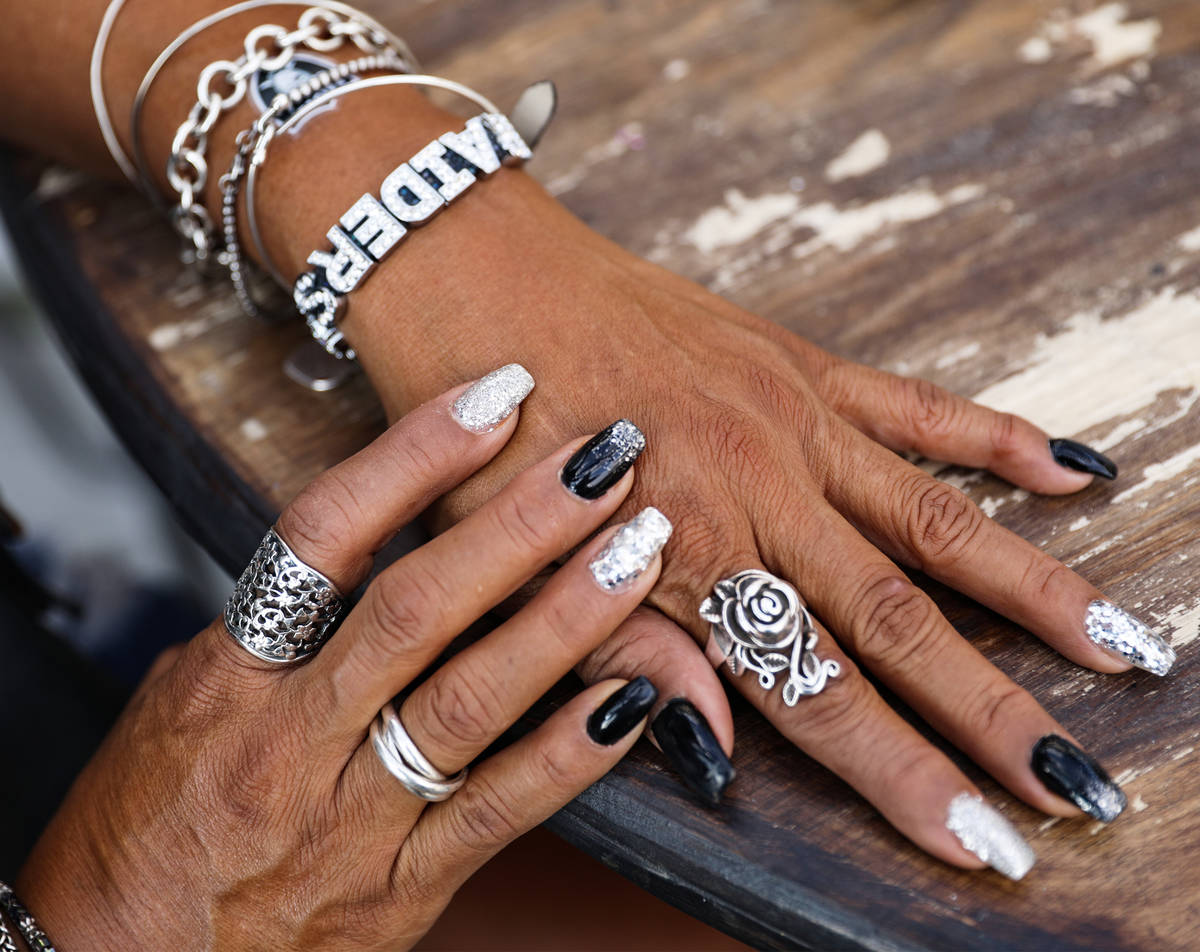 Rosemary Gonzales shows off her nails and jewelry at PKWY Tavern ahead of the Raiders first hom ...