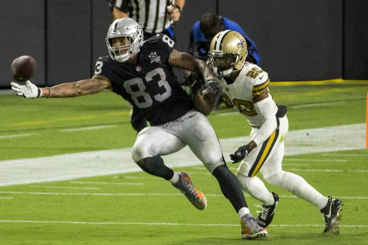 Las Vegas Raiders tight end Darren Waller (83, left) reaches out for critical catch over New Or ...