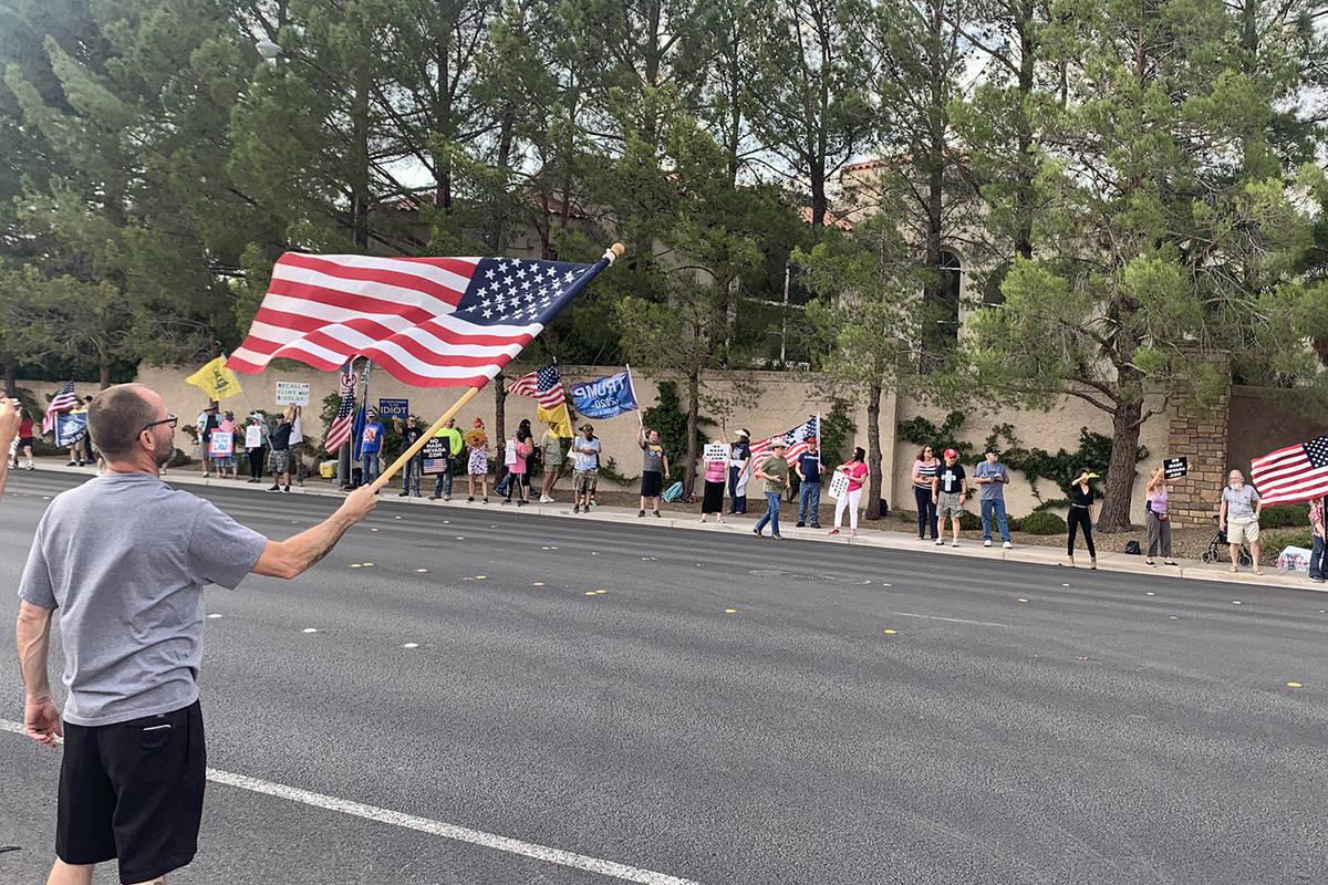 No Mask Nevada holds a rally near Gov. Steve Sisolak's southwest Las Vegas home on Monday, Se ...