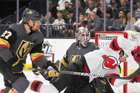 Vegas Golden Knights goaltender Robin Lehner (90) makes a save against New Jersey Devils left w ...