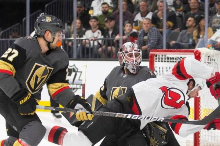 Vegas Golden Knights goaltender Robin Lehner (90) makes a save against New Jersey Devils left w ...