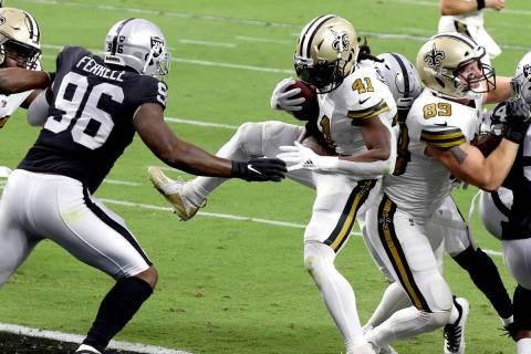New Orleans Saints running back Alvin Kamara (41) scores a touchdown against the Las Vegas Raid ...