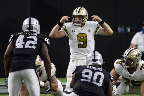 New Orleans Saints quarterback Drew Brees (9) directs traffic in the first quarter during an NF ...