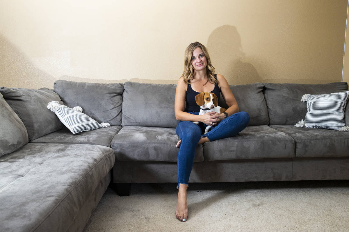Route 91 survivor Christina Gruber sits with her dog, Max, whom she got shortly after the shoot ...