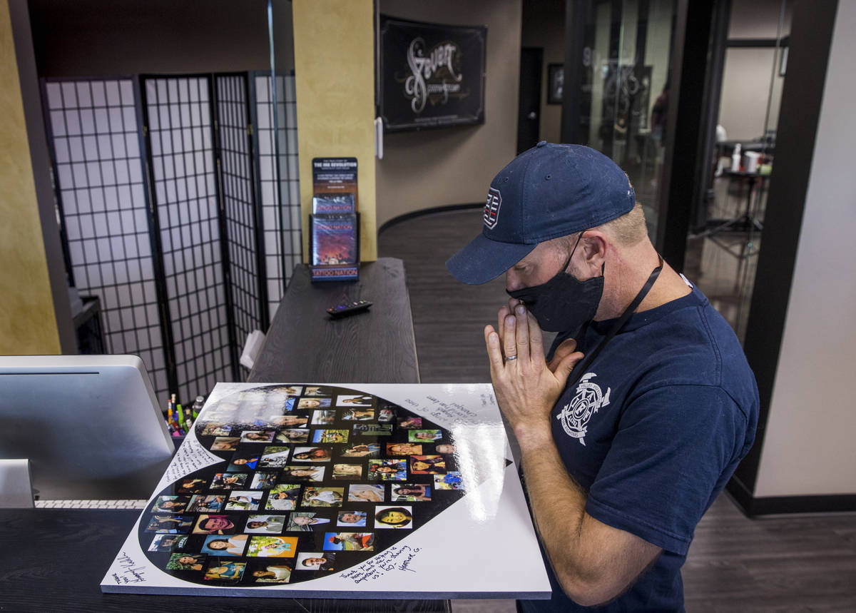 Seattle firefighter Dean McAuley pauses to remember all the victims as Route 91 shooting surviv ...