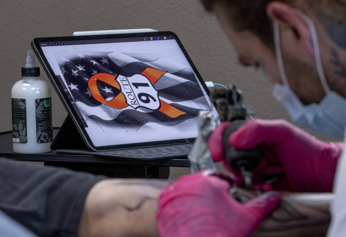 Tattoo artist Jimmy Snaz recreates his computer drawing on Joe Gerransnas Route 91 shooting sur ...