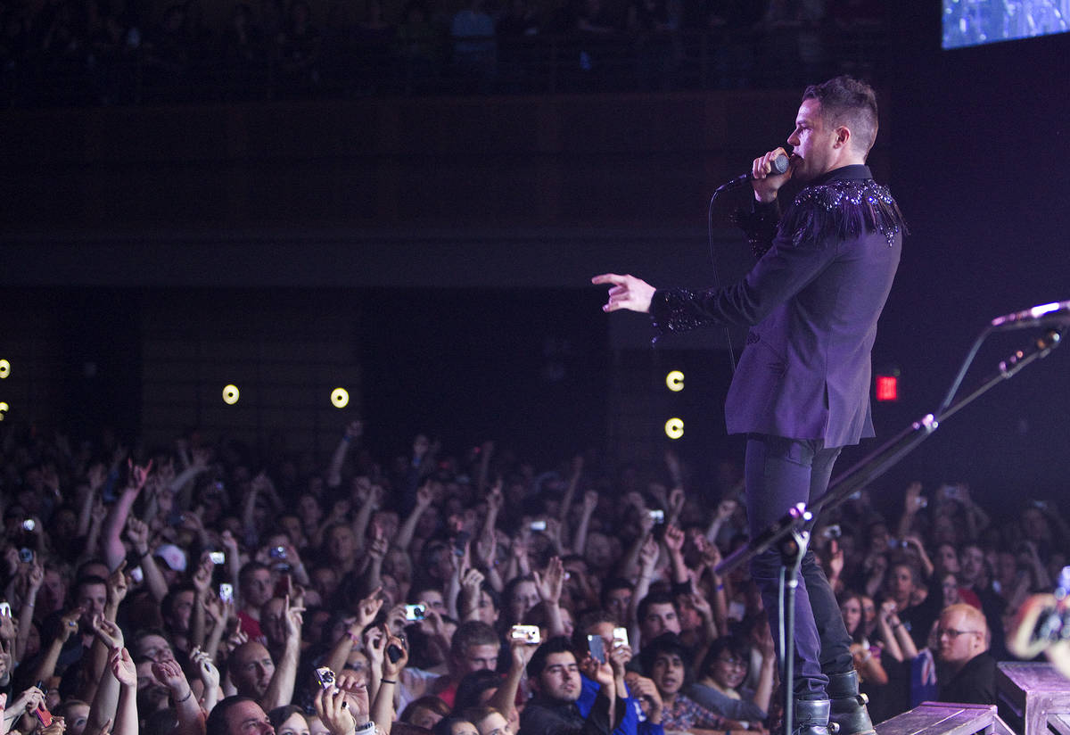 Brandon Flowers of The Killers performs with the band to a sold-out crowd during the opening ni ...