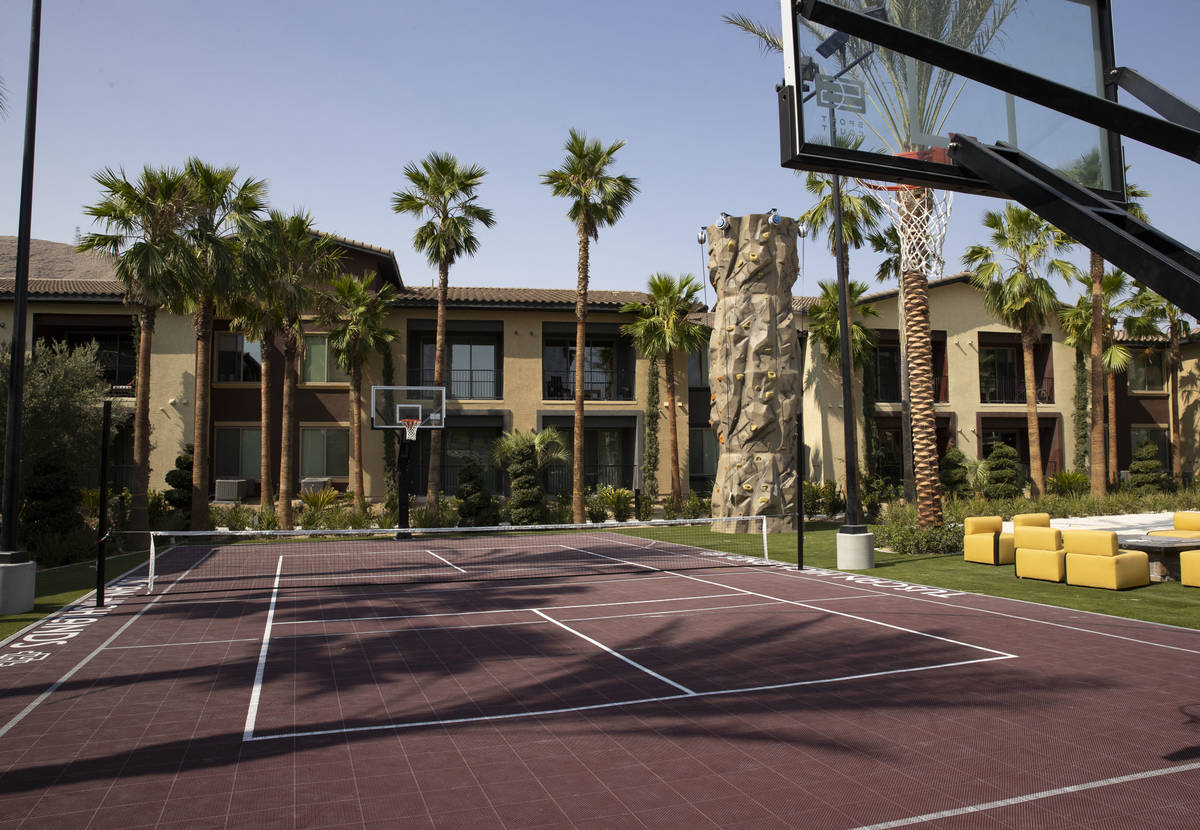 A tennis court and basketball court are seen at the Tuscan Highlands apartment complex under co ...
