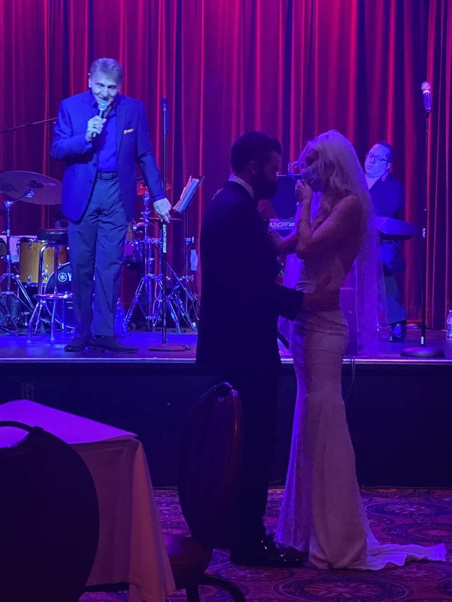 Carmine Mandina sings to a pair of newlyweds at Italian American Club on July 26, 2020. (John K ...