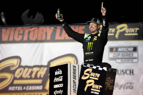 Kurt Busch (1), of Las Vegas, celebrates in Victory Lane after winning a NASCAR Cup Series auto ...