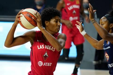 Connecticut Sun guard Jasmine Thomas (5) fouls Las Vegas Aces guard Danielle Robinson (3) durin ...