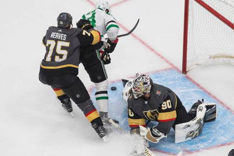 Dallas Stars' Jamie Benn (14) is stopped by Vegas Golden Knights' goalie Robin Lehner (90) as G ...