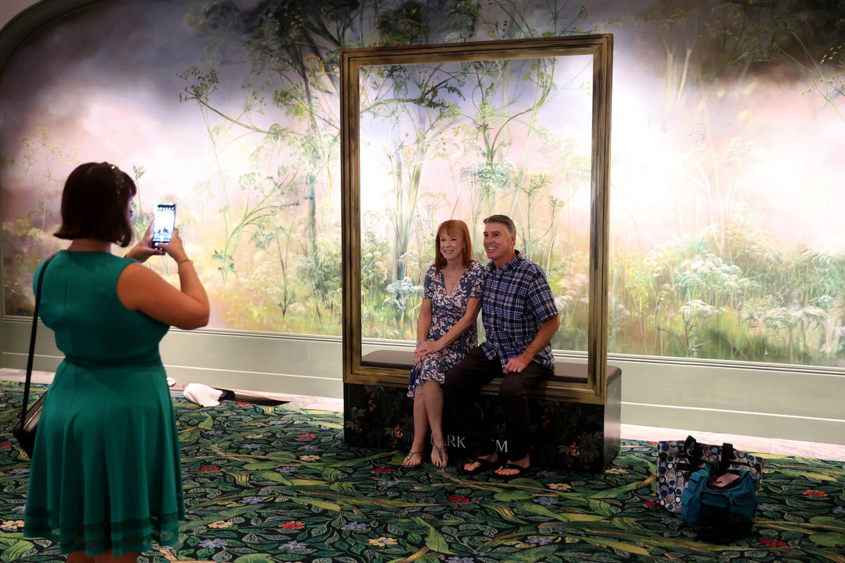 Lucy Angelo of Las Vegas takes a photo of Tim and Alisa Gaw of Phoenix as Park MGM reopens afte ...