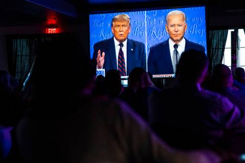 Supporters of President Donald Trump cheer during a debate watch party at Rhythm Kitchen in Las ...