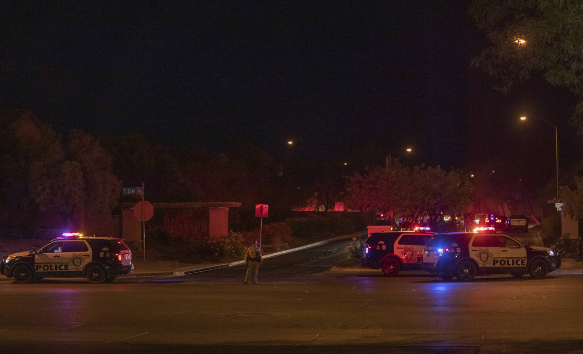 Las Vegas police are seen blocking West Erie Ave. and South Cochiti Lake St in Las Vegas, on Tu ...