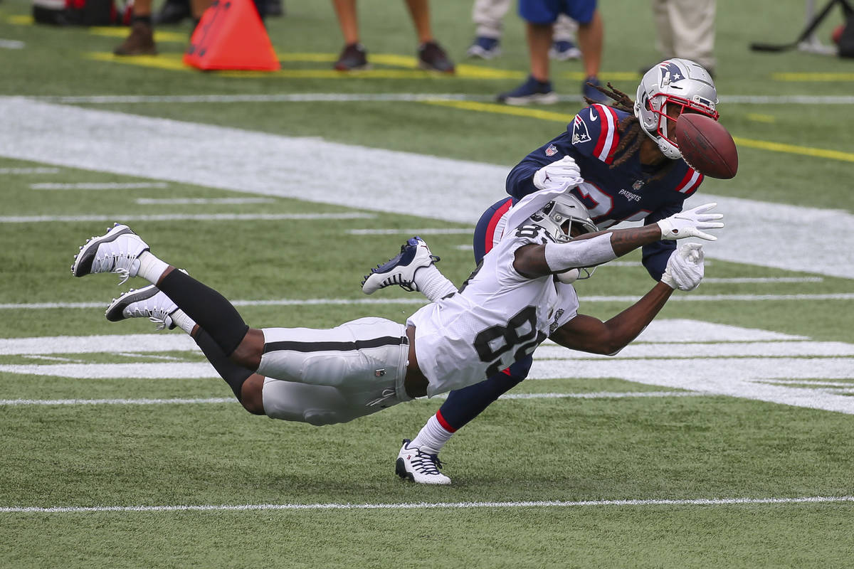 New England Patriots cornerback Stephon Gilmore (24) breaks up a pass intended for Las Vegas Ra ...