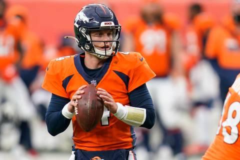 Denver Broncos quarterback Brett Rypien throws a pass during the second half of an NFL football ...