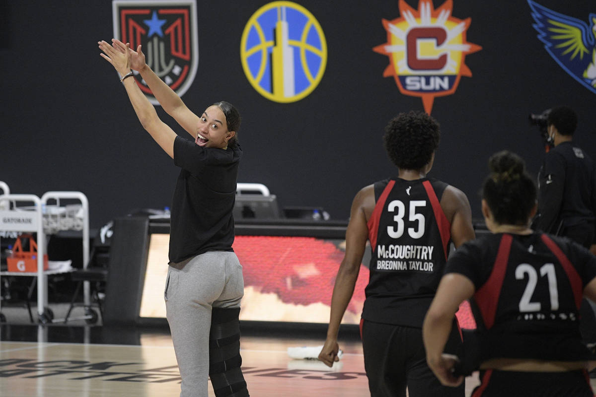 Las Vegas Aces forward Dearica Hamby, left, celebrates with forward Angel McCoughtry (35) and g ...