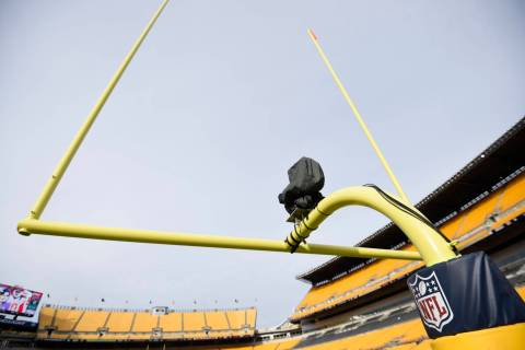 A television camera is mounted on the goal post at Heinz Field before an NFL football game betw ...