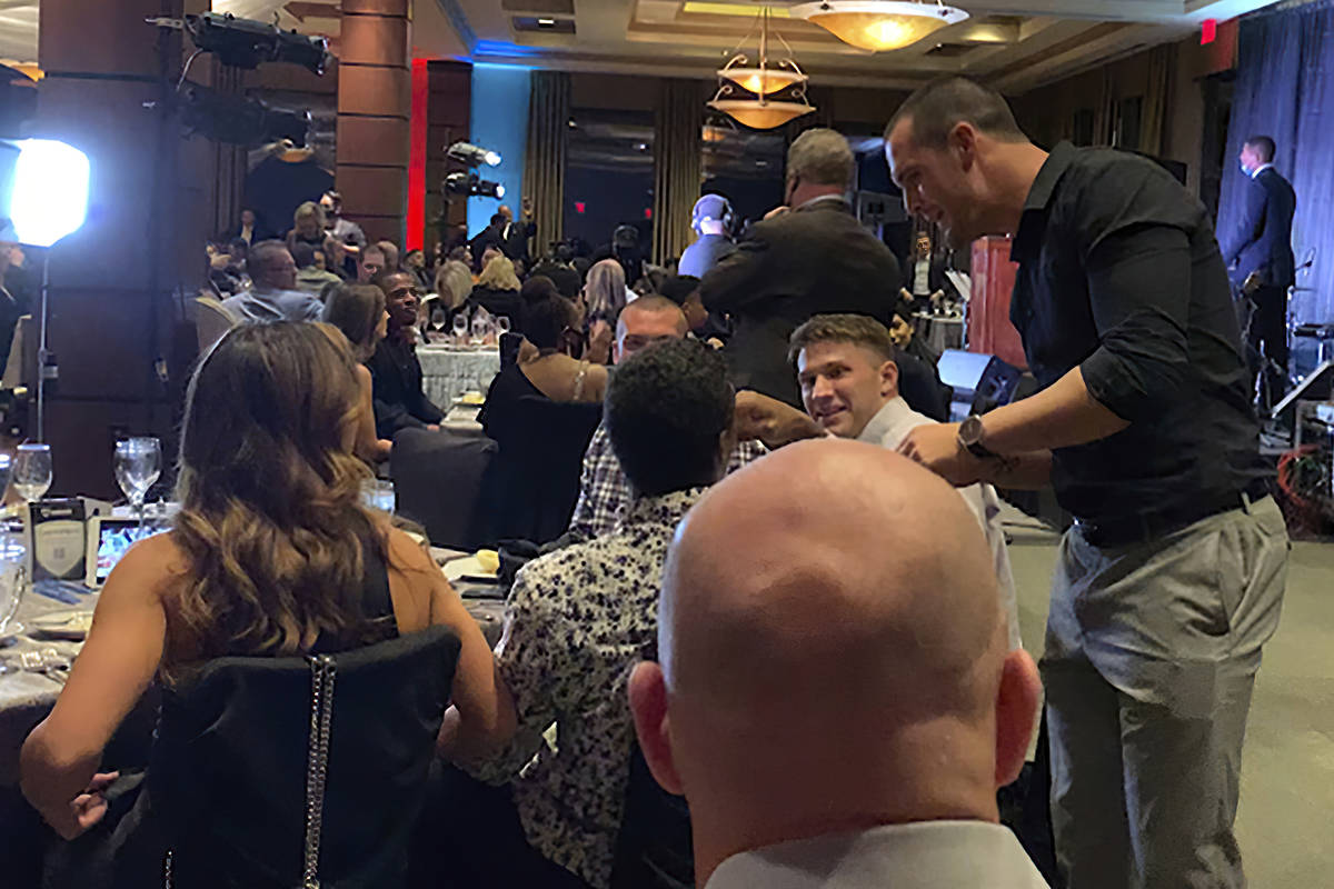 In this still image taken from video, Las Vegas Raiders quarterback Derek Carr, right, meets wi ...