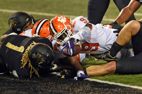 Clemson running back Travis Etienne reaches out to score against Wake Forest during the second ...